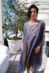 Floaty chiffon  kaftan with semi precious beaded detail and turquoise bead trim. P.O.A. www.shicashmere.com